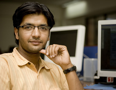 Indian_man_staring_at_your_computer_in_the_background
