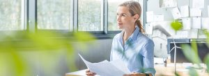 Female-overviews-the-benefits-of-csr-within-her-office-surrounded-by-plants
